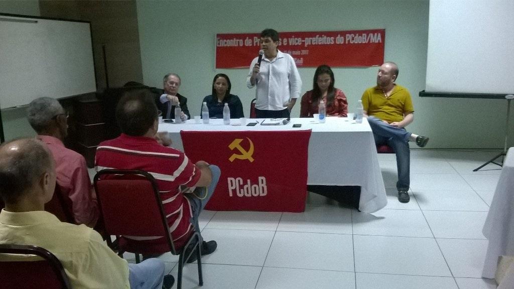 Investigado por corrupção ganha destaque em evento do PCdoB